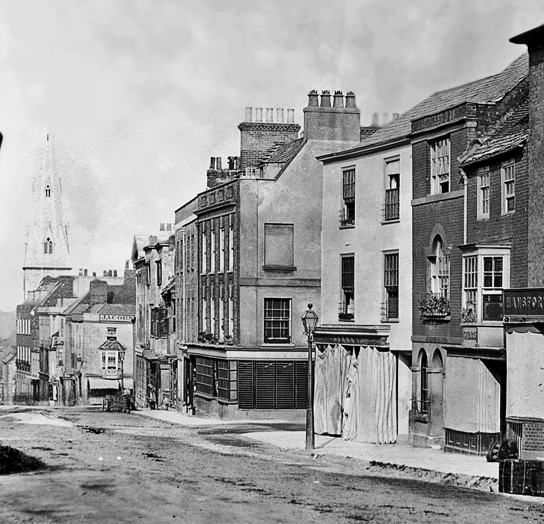 High West Street, Dorchester, c1860. The Davis's premises were in the building on the corner of the side street. Photograph courtesy of Dorset County Museum.